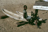 Senegal, children with small carved boats
