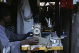 Senegal, man sitting at sewing machine