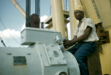 Senegal, man operating machinery
