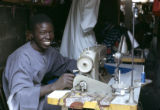 Senegal, man with sewing machine