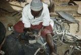 Burkina Faso, man making shoes from old rubber tires