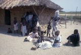 Senegal, family outside of rural house