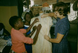 Senegal, girls learning to shape a dress
