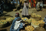 Burkina Faso, women selling mangos at market