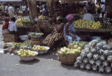 Côte d'Ivoire, merchants selling fruit at Abidjan market