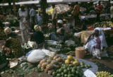 Côte d'Ivoire, vendors selling fruit and other goods at Abidjan market