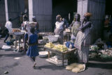 Côte d'Ivoire, women selling fruits and other goods at Abidjan market