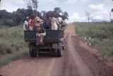 Africa, people riding in truck in the East