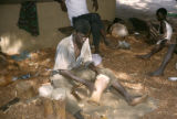 Côte d'Ivoire, woodcarver making small drums