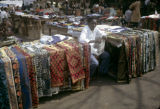 Côte d'Ivoire, vendor selling clothing and textiles at Abidjan market