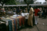 Côte d'Ivoire, vendor selling textiles and clothing at Abidjan market