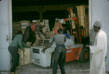 Côte d'Ivoire, dock workers moving products