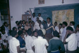 Côte d'Ivoire, teacher lecturing in classroom of students