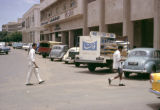 Sudan, cars parked along business street in Khartoum