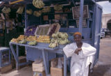 Sudan, merchant selling fruit from stand