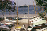 Tanzania, view of cargo ship beyond docked boats on Dar es Salaam shore