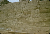 Egypt, hieroglyphics on ruins of stone wall in ancient Thebes
