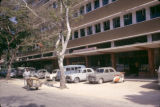 Tanzania, cars parked along modern building in Dar es Salaam