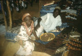 Nigeria, father and daughter in textile shop
