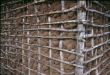 Tanzania, mud wall reinforced with lattice of poles