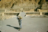 Egypt, water carrier at Mortuary Temple of Queen Hatshepsut at ancient Thebes
