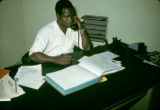 Nigeria, businessman making telephone call at desk