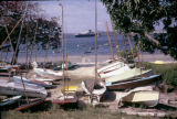 Tanzania, docked boats along shore of Dar es Salaam harbor