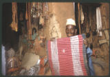 Nigeria, merchant selling saddle blanket and other goods