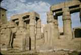 Egypt, ruins of sculpture and columns at ancient Thebes