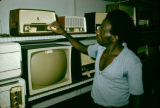 Africa, man at radio and TV store