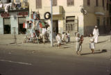 Egypt, children gathered near sidewalk amusement ride