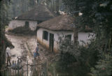 Ethiopia, people outside thatched-roof homes