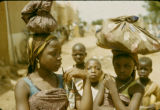 Nigeria, Fula girls carrying goods on heads
