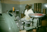 Nigeria, worker operating machinery at Nicco Sweets Factory in Kano
