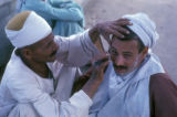Cairo (Egypt), barber shaving a man