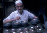 Cairo (Egypt), craftsman poring metal into molds
