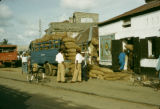 Nigeria, loading bagged peanuts onto truck