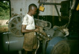 Nigeria, man operating machinery at factory