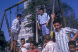 Cairo (Egypt), boys playing on a swing set