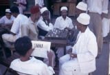 Tanzania, Arab men playing board game at café in Zanzibar