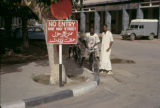 Sudan, people near No Entry sign in English and Arabic