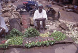 Ethiopia, man selling vegetables at outdoor market