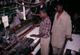 Nigeria, textile factory workers operating loom