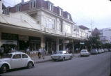 Tanzania, cars parked along commercial street in Dar es Salaam