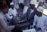 Tanzania, men playing board game in Zanzibar