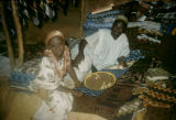 Nigeria, Igbo merchant and daughter selling textiles