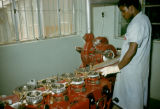 Nigeria, man operating machinery at Nicco Sweets Factory in Kano