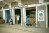 Nigeria, men outside United India Company in Kano