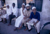 Tanzania, Arab men sitting outside café in Zanzibar