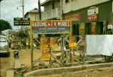Nigeria, signs outside radio and TV store in Ibadan